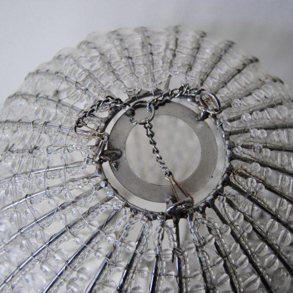 Suspension en perles transparentes