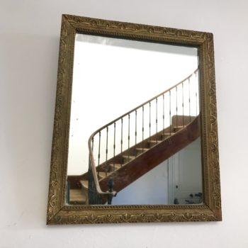 Miroir ancien en bois et stuc doré dos cartonné